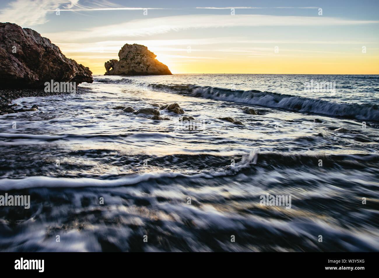 Orange sunset over a calm ocean, Malaga Beach - Stock Image