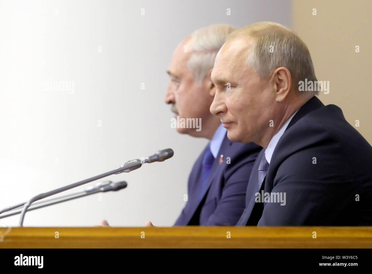 St Petersburg, Russia. 18th July, 2019. ST PETERSBURG, RUSSIA - JULY 18, 2019: Russia's President Vladimir Putin (front) and Belarus' President Alexander Lukashenko attend a plenary meeting at the 5th Belarus-Russia Forum of Regions, Tauride Palace. Mikhail Klimentyev/Russian Presidential Press and Information Office/TASS Credit: ITAR-TASS News Agency/Alamy Live News - Stock Image