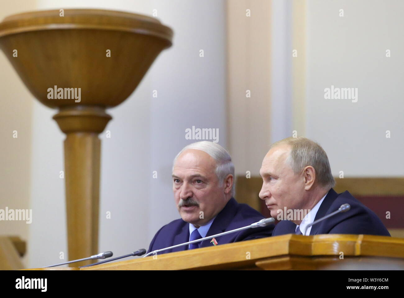 St Petersburg, Russia. 18th July, 2019. ST PETERSBURG, RUSSIA - JULY 18, 2019: Belarus' President Alexander Lukashenko (L) and Russia's President Vladimir Putin attend a plenary meeting at the 5th Belarus-Russia Forum of Regions, Tauride Palace. Mikhail Klimentyev/Russian Presidential Press and Information Office/TASS Credit: ITAR-TASS News Agency/Alamy Live News - Stock Image