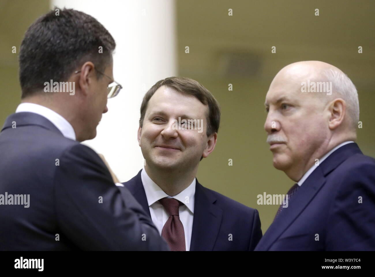 St Petersburg, Russia. 18th July, 2019. ST PETERSBURG, RUSSIA - JULY 18, 2019: Russia's Energy Minister Alexander Novak, Economic Development Minister Maxim Oreshkin, and Ambassador to Belarus Dmitry Mezentsev (L-R) attend a meeting between the Presidents of Russia and Belarus at the Tauride Palace. Mikhail Metzel/TASS Credit: ITAR-TASS News Agency/Alamy Live News - Stock Image
