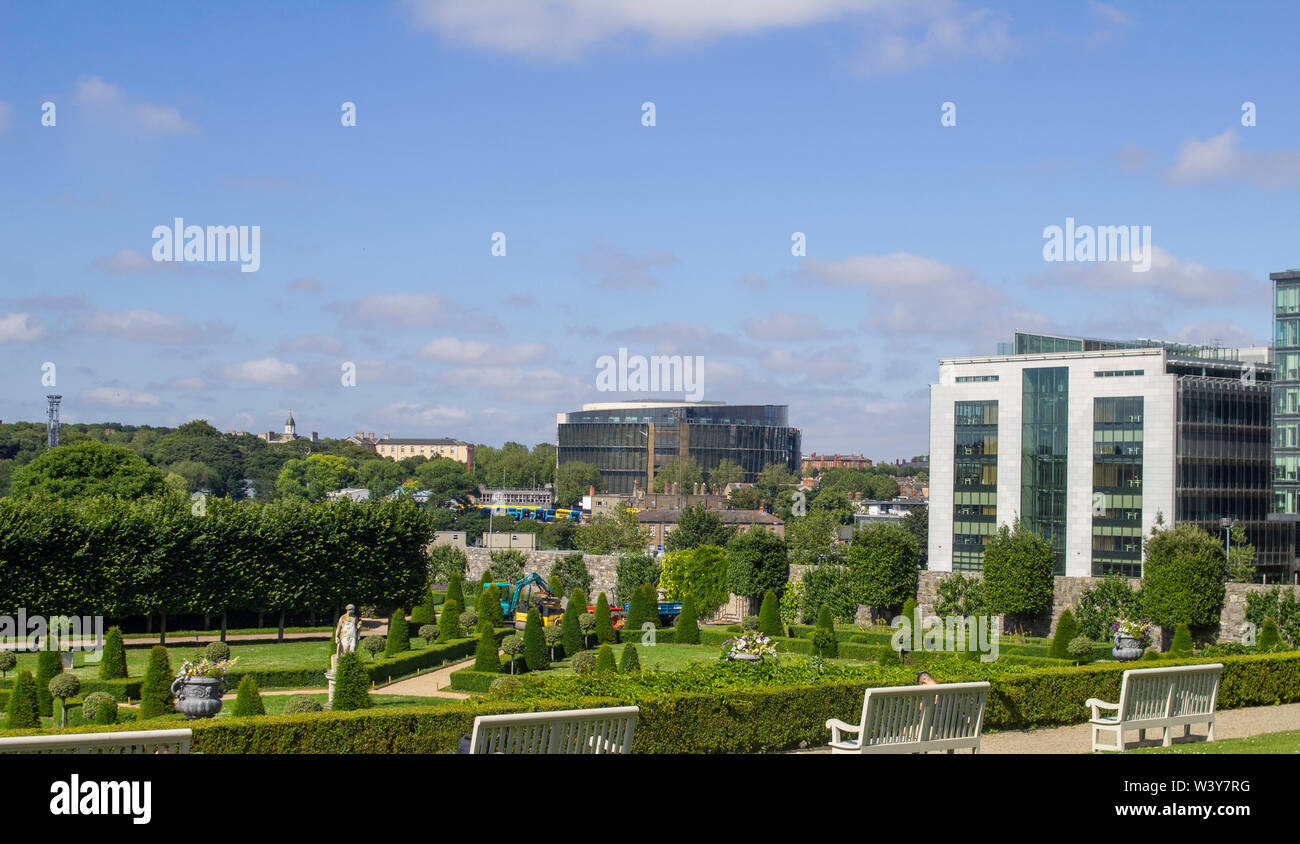 The formal gardens of The Royal Hospital, Kilmainhan, Dublin, Ireland and in the background the Heuston Quarter and the new Central Criminal Court. - Stock Image