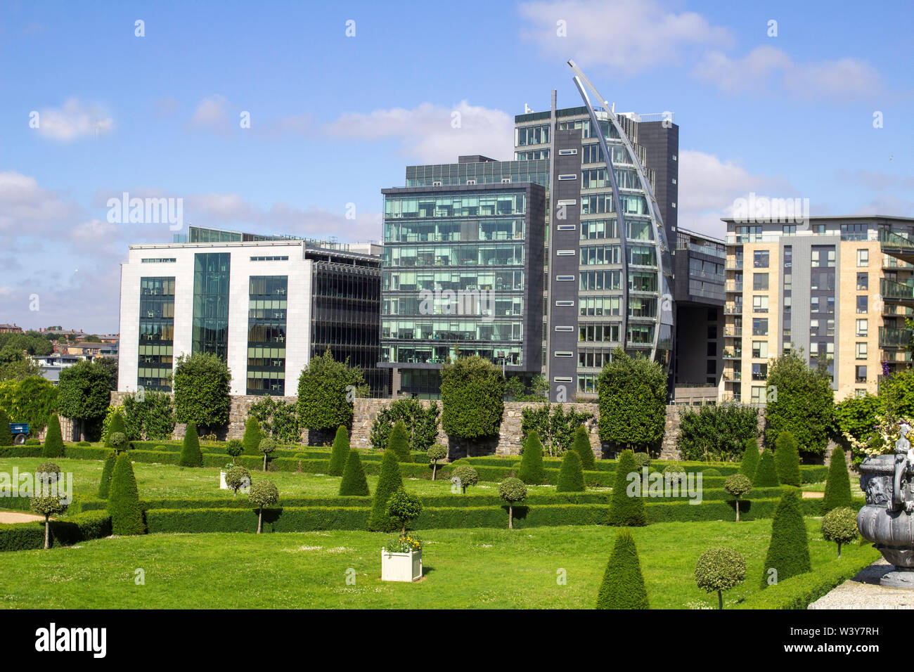The formal gardens of The Royal Hospital, Kilmainhan, Dublin, Ireland and in the background the Heuston Quarter office, apartment and retail complex. - Stock Image