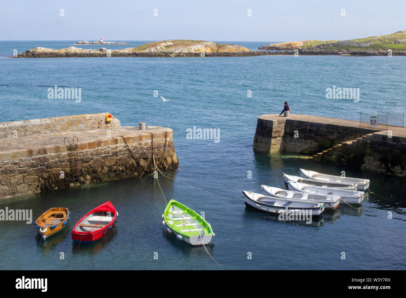 Small boats tied up in Coliemore Harbour in Dalkey, County Dublin, Ireland. In the middle ages it was the main harbour for the city of Dublin. - Stock Image