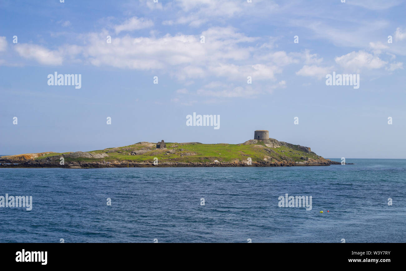 Dalkey Island opposite Coliemore Harbour in Dalkey, County Dublin, Ireland. A Martello Tower erected in the 19th century can also be seen. - Stock Image
