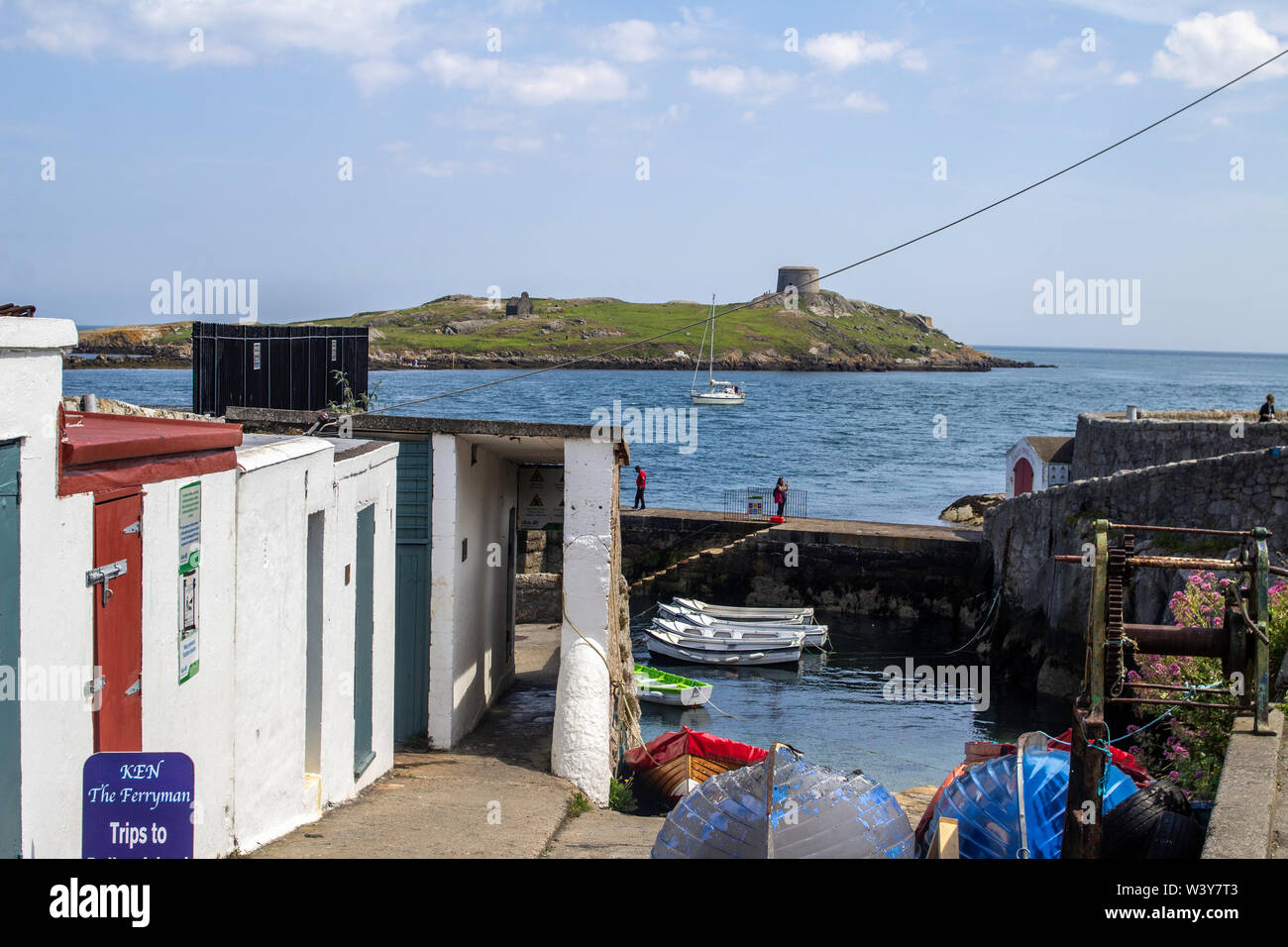 The entrance to Coliemore Harbour in Dalkey, County Dublin, Ireland, with Dalkey Island in the background. - Stock Image
