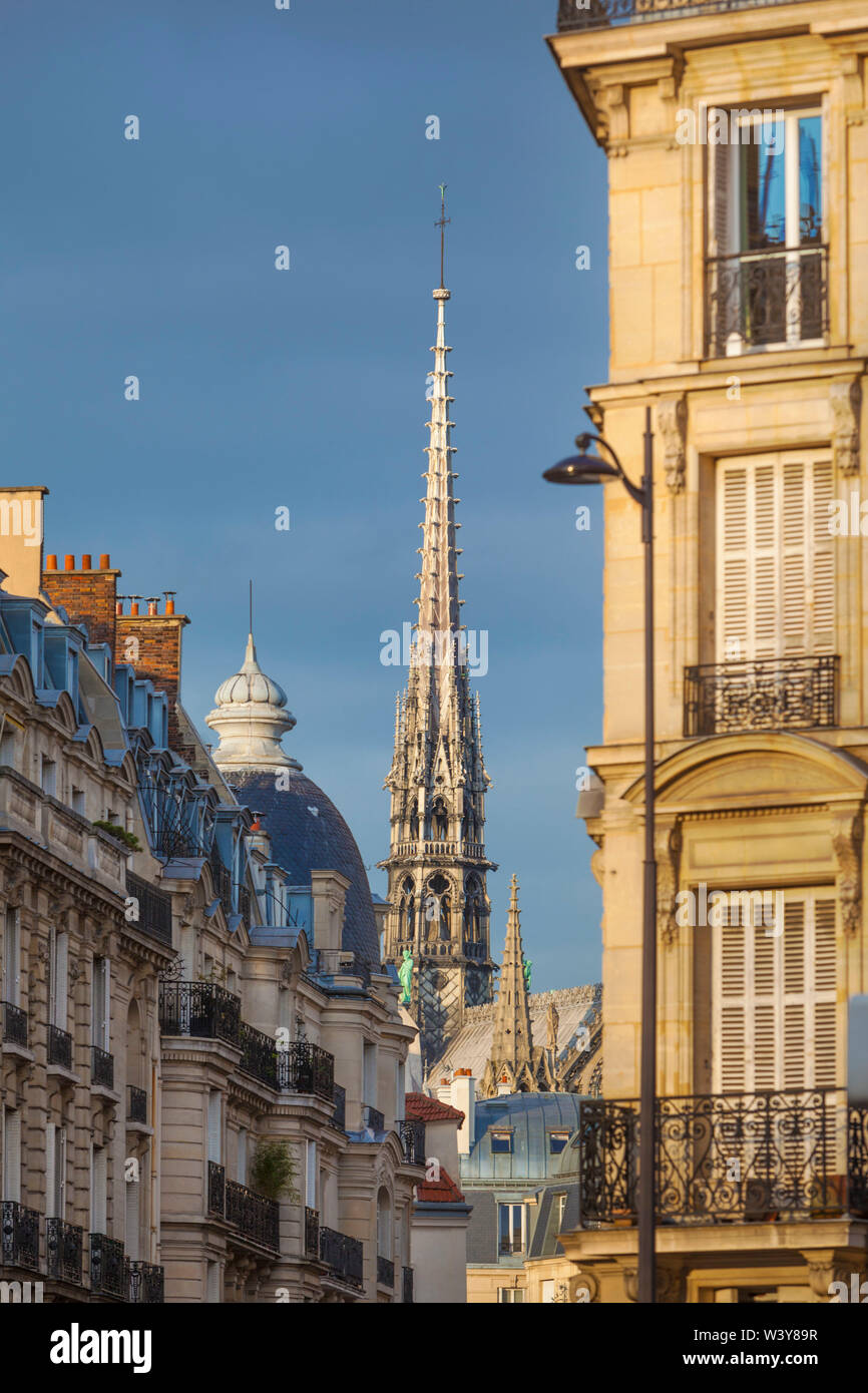 France, Paris, Notre Dame Cathedral, spire above rooftops - Stock Image
