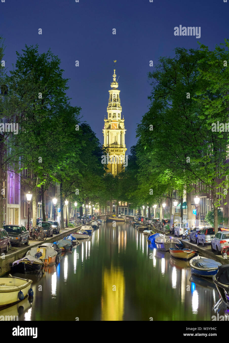 Tower of Zuiderkerk church from Groenburgwal at night, Amsterdam, North Holland, Netherlands - Stock Image