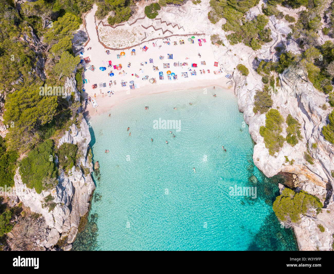 Aerial view of Cala Macarelleta beach crowded in summer, Menorca, Balearic Islands, Spain - Stock Image