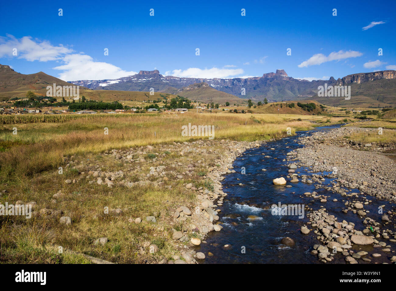 African landscape and scenic panoramic view onto the Drakensberg mountains and snow covered Amphitheatre region Kwazulu Natal, South Africa in Winter Stock Photo
