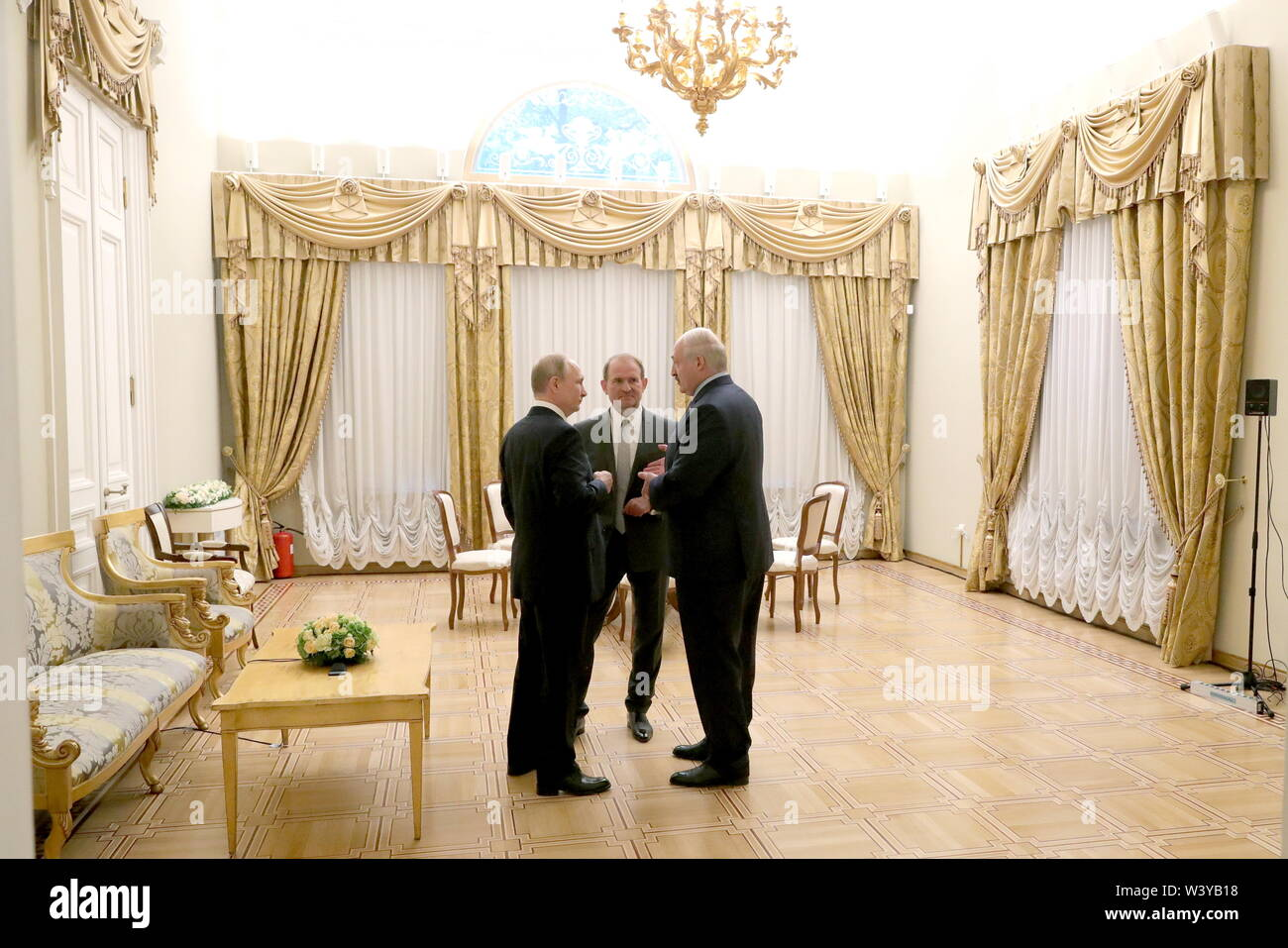 St Petersburg, Russia. 18th July, 2019. ST PETERSBURG, RUSSIA - JULY 18, 2019: Russia's President Vladimir Putin, Viktor Medvedchuk, Chairman of the Ukrainian Opposition Platform - For Life, and Belarus' President Alexander Lukashenko during a meeting at the Tauride Palace. Mikhail Klimentyev/Russian Presidential Press and Information Office/TASS Credit: ITAR-TASS News Agency/Alamy Live News - Stock Image