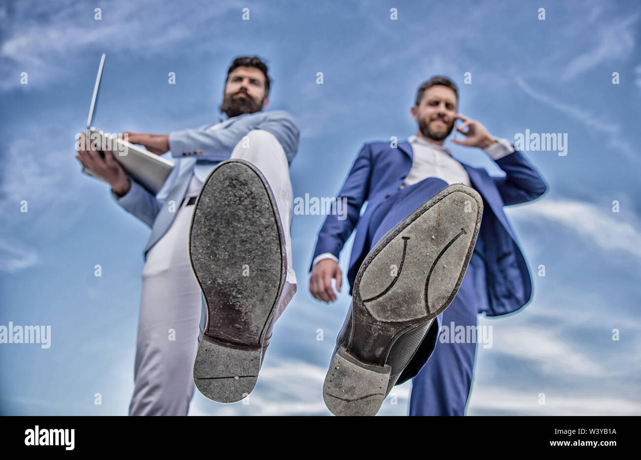 Businessmen making step bottom view. Business technologies coming. Big step for entrepreneurship. Smashing competitiveness. Business partner busy with phone call moving forward, foot shoe close up. - Stock Image