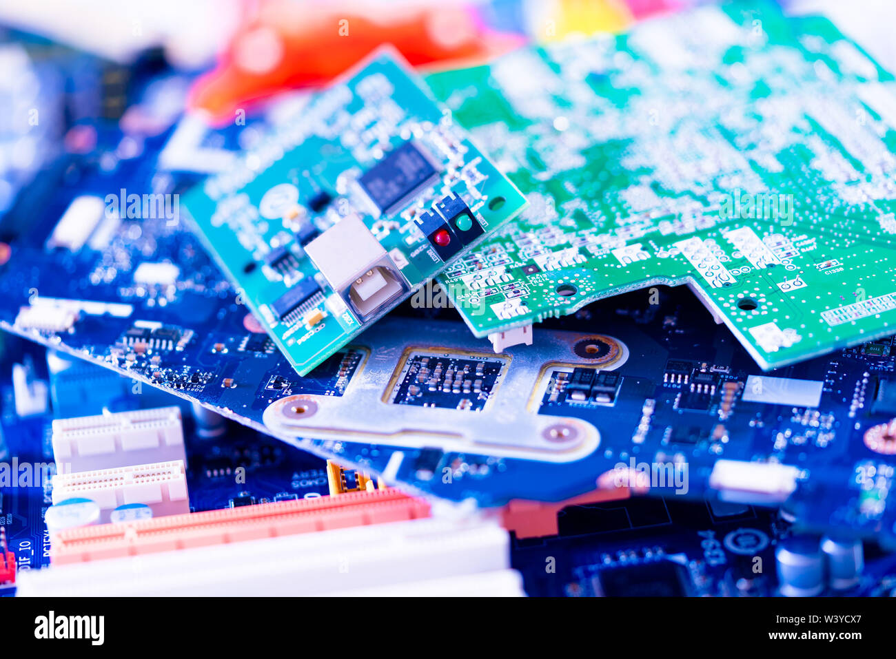 electronic PCB garbage as background from recycle industry and old consumer devices - Stock Image