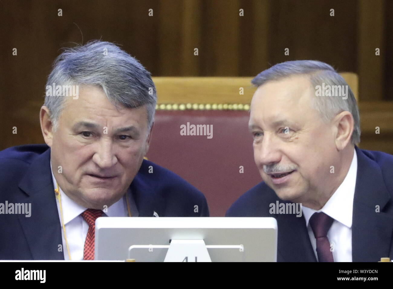 St Petersburg, Russia. 18th July, 2019. ST PETERSBURG, RUSSIA - JULY 18, 2019: Yuri Vorobyov (L), Deputy Chairman of the Russian Federation Council, and acting St Petersburg Governor Alexander Beglov attend a plenary meeting at the 5th Belarus-Russia Forum of Regions, Tauride Palace. Mikhail Metzel/TASS Credit: ITAR-TASS News Agency/Alamy Live News - Stock Image