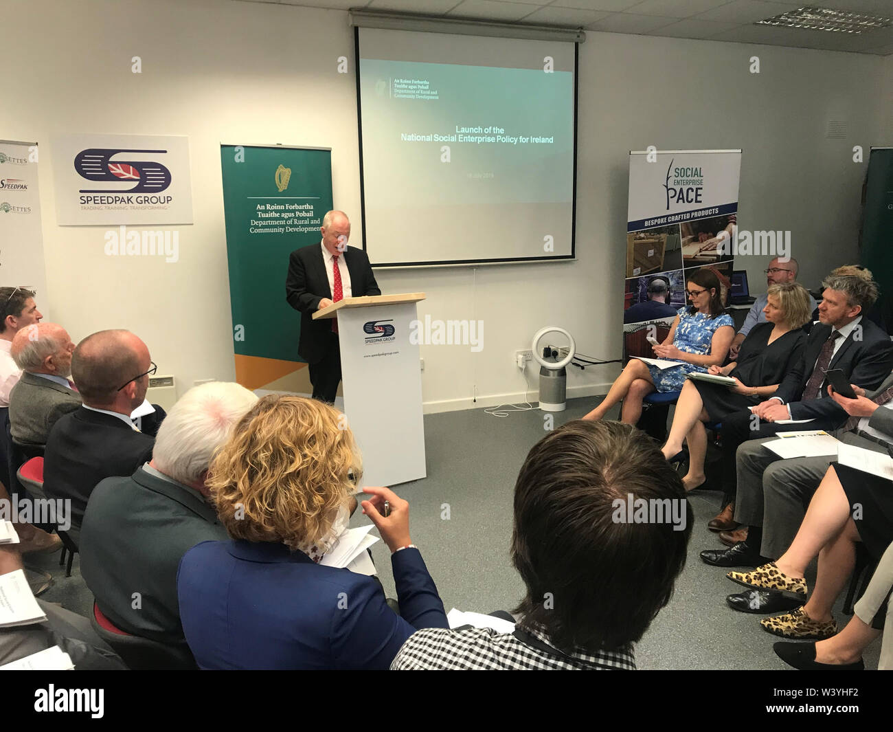 Rural and Community Development Minister Michael Ring discussing the Government's first-ever Social Enterprise Policy for Ireland. The policy was launched at Speedpak, a social enterprise in Coolock, north Dublin on Thursday. - Stock Image