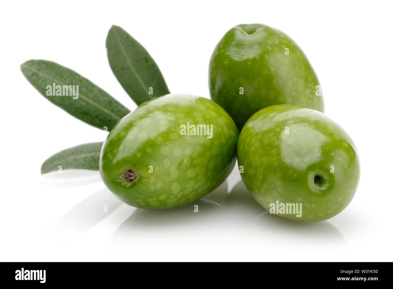 Green olives with leaves isolated on white background - Stock Image