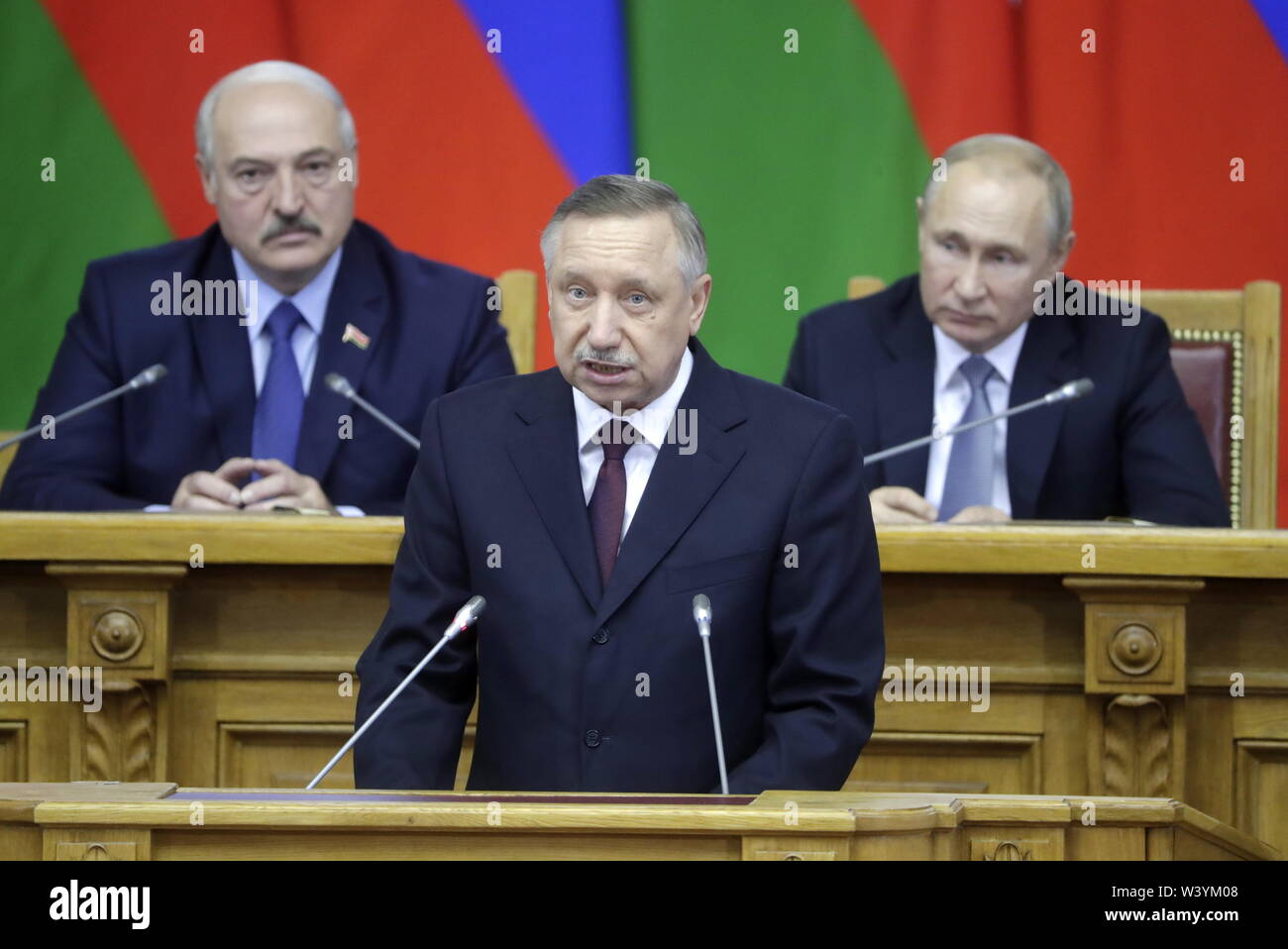 St Petersburg, Russia. 18th July, 2019. ST PETERSBURG, RUSSIA - JULY 18, 2019: Belarus' President Alexander Lukashenko and Russia's President Vladimir Putin (L-R back) listen as acting St Petersburg Governor Alexander Beglov addresses a plenary meeting at the 6th Belarus-Russia Forum of Regions, Tauride Palace. Mikhail Metzel/TASS Credit: ITAR-TASS News Agency/Alamy Live News - Stock Image