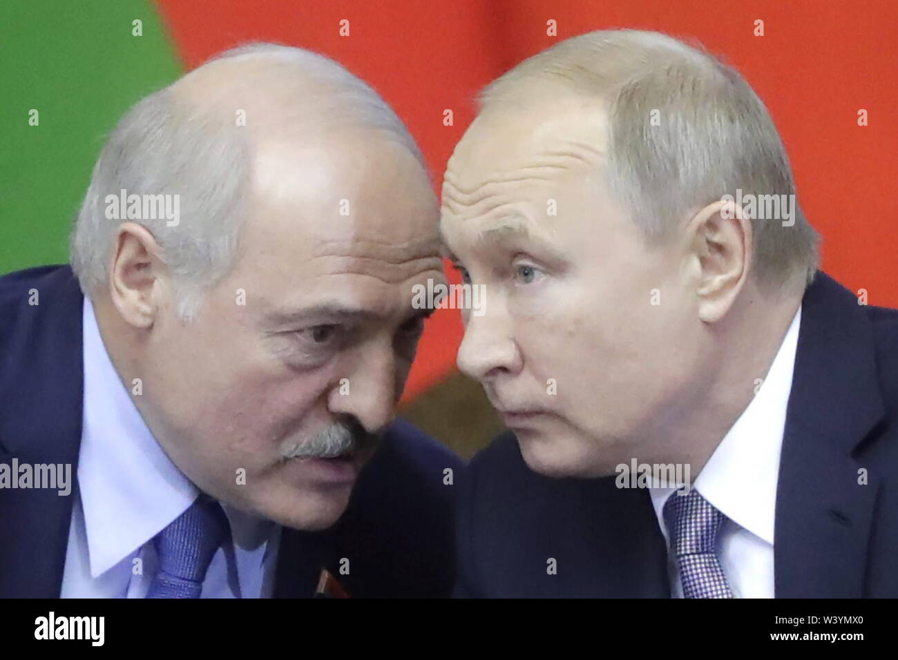 St Petersburg, Russia. 18th July, 2019. ST PETERSBURG, RUSSIA - JULY 18, 2019: Belarus' President Alexander Lukashenko (L) and Russia's President Vladimir Putin attend a plenary meeting at the 6th Belarus-Russia Forum of Regions, Tauride Palace. Mikhail Metzel/TASS Credit: ITAR-TASS News Agency/Alamy Live News - Stock Image