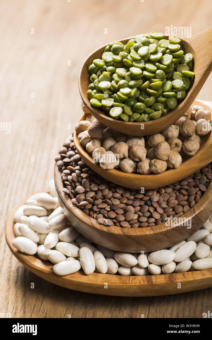 composition of dry legumes of different types, color and flavor in the foreground - Stock Image