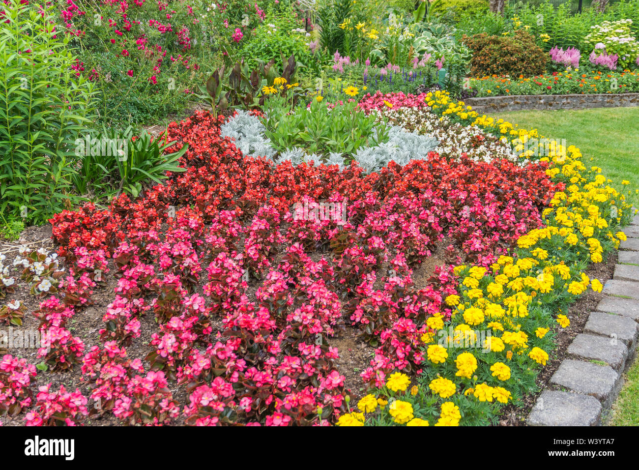 A view of a lawn and flower garden at Point Defiance Park in Tacoma, Washington. - Stock Image
