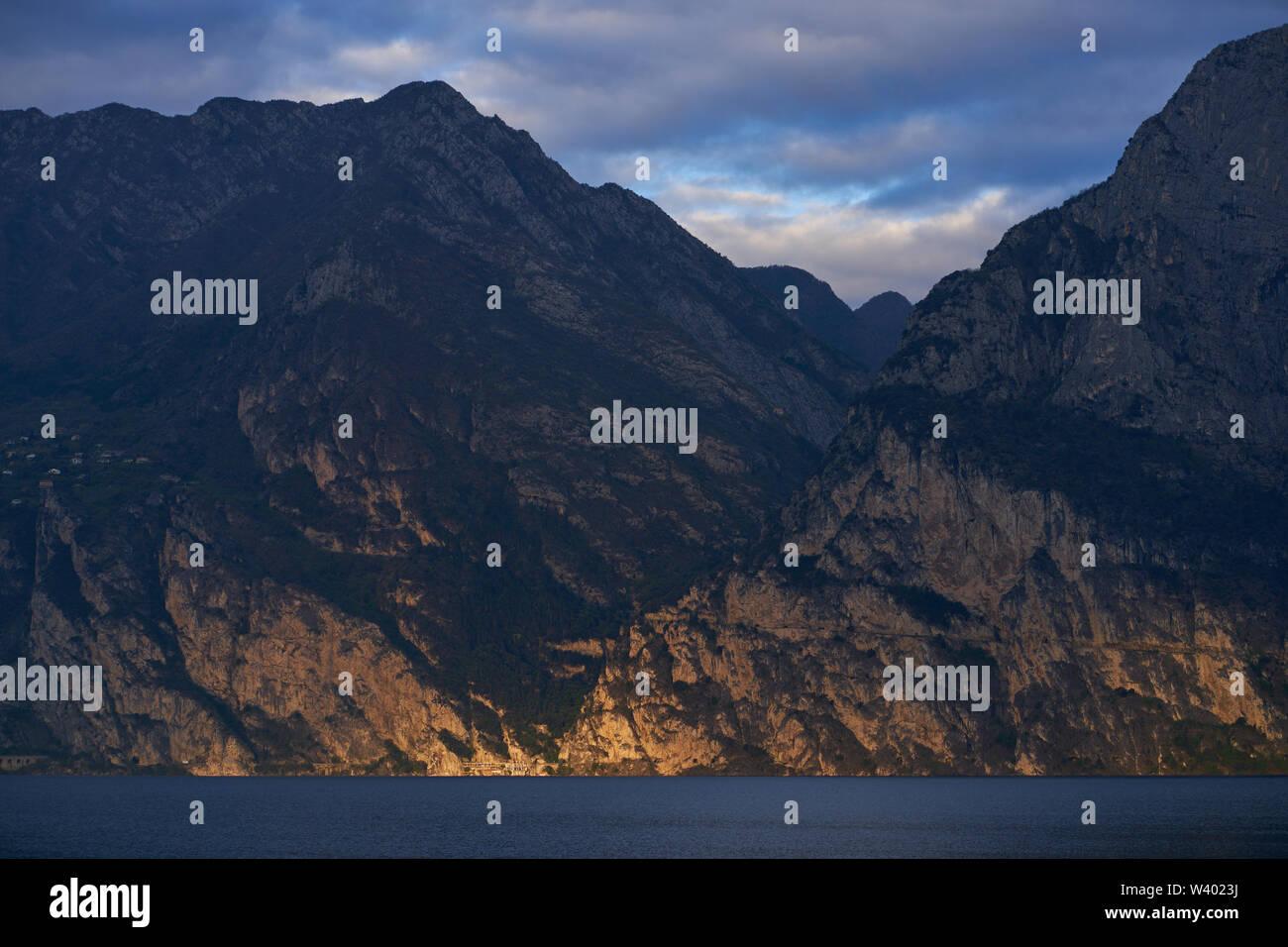 North beach with sunrise, Pregasina village, Cima della Nara at Lago di Garda, Lake Garda in Torbole - Nago, Riva, Trentino , Italy at April 15, 2019. - Stock Image