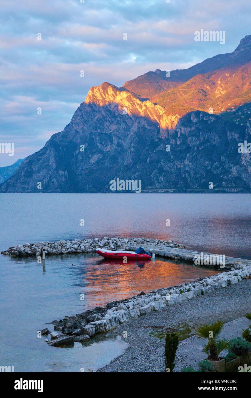 North beach with sunrise, Pregasina village, at Lago di Garda, Lake Garda in Torbole - Nago, Riva, Trentino , Italy at April 15, 2019. © Peter Schatz - Stock Image