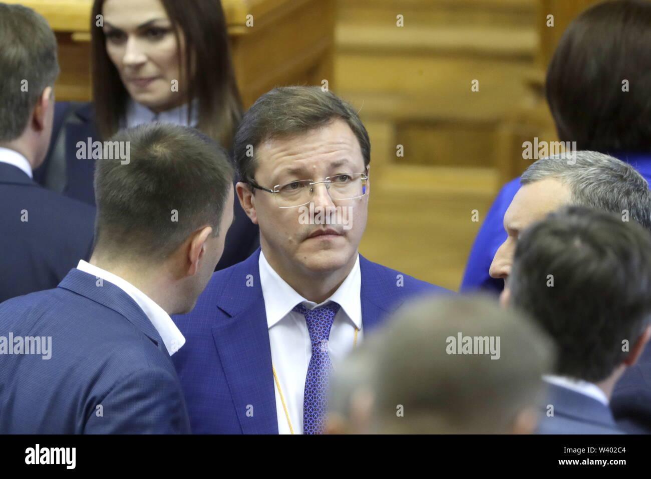 ST PETERSBURG, RUSSIA - JULY 18, 2019: Samara Region Governor Dmitry Azarov (C) attends a plenary meeting at the 6th Belarus-Russia Forum of Regions, Tauride Palace. Mikhail Metzel/TASS - Stock Image