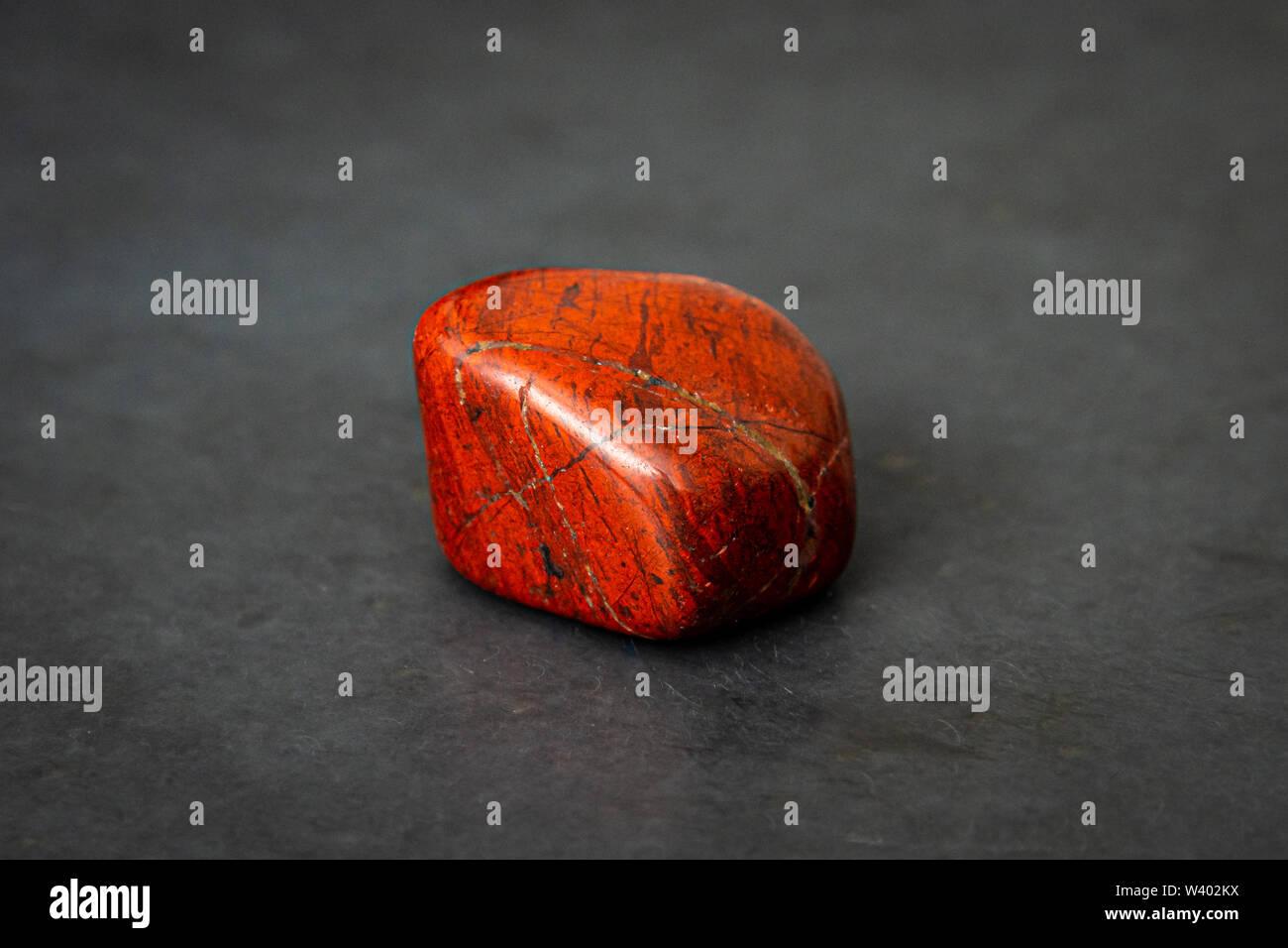 Breckzien jasper gem shining in powerful tones of deep red - Stock Image