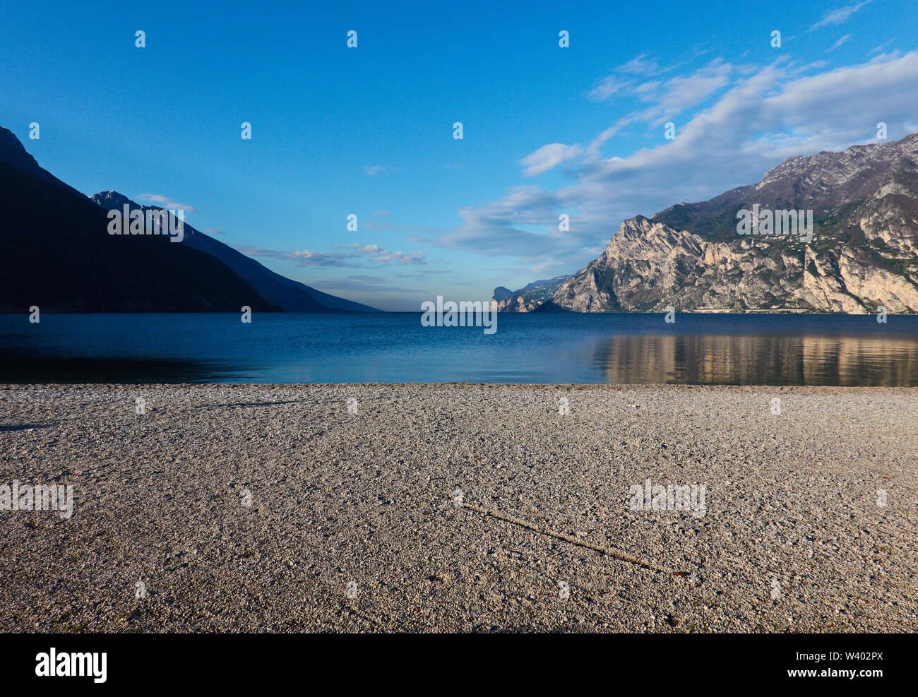 North beach on sunrise at Lago di Garda, Lake Garda in Torbole - Nago, Riva, Trentino , Italy at April 15, 2019. © Peter Schatz / Alamy Stock Photos - Stock Image