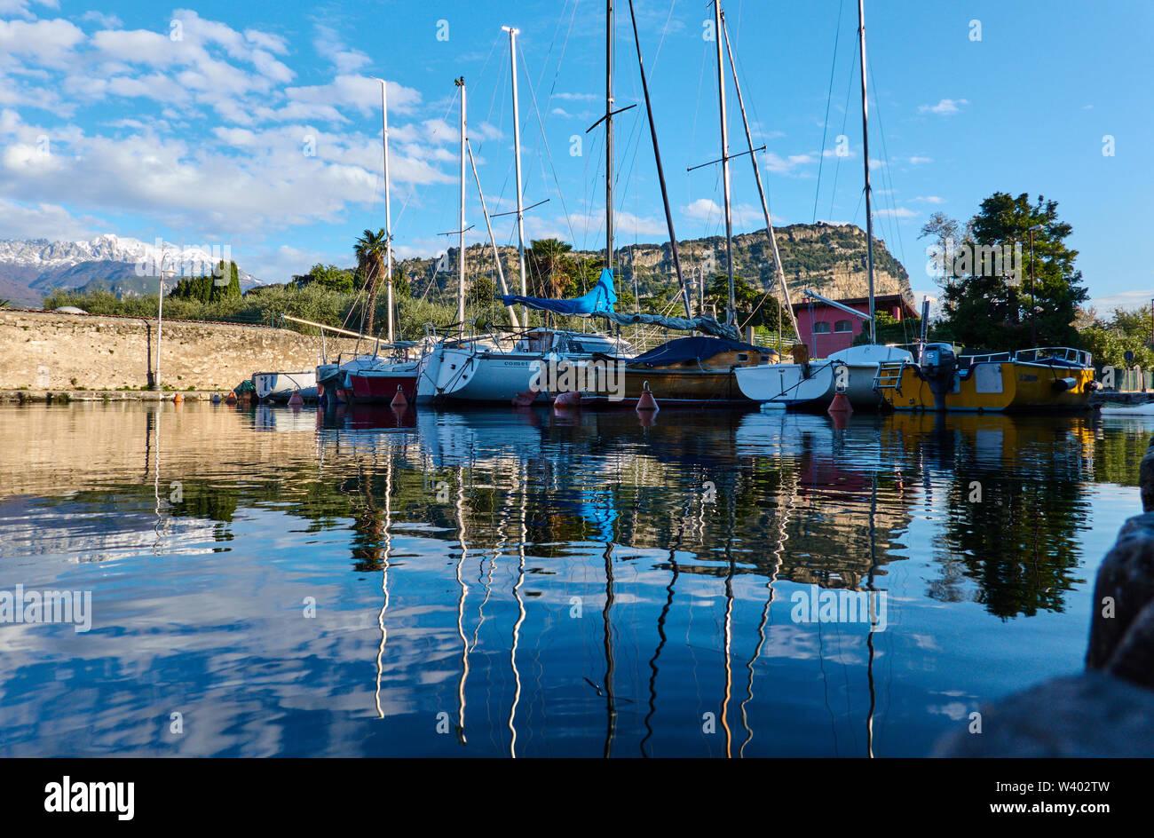 Small harbor Porticcioloat Lago di Garda, Lake Garda in Torbole - Nago, Riva, Trentino , Italy at April 15, 2019. © Peter Schatz / Alamy Stock Photos - Stock Image