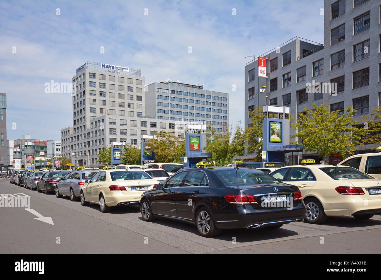 Mannheim, Germany - July 2019: Many taxi cars in different colors parking and waiting for passangers in front of Mannheim main station - Stock Image