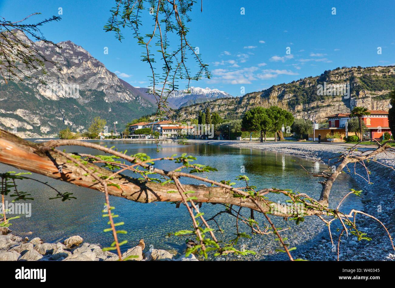 The beach near small harbor Porticcioloat Lago di Garda, Lake Garda in Torbole - Nago, Riva, Trentino , Italy at April 15, 2019. © Peter Schatz / Alam - Stock Image