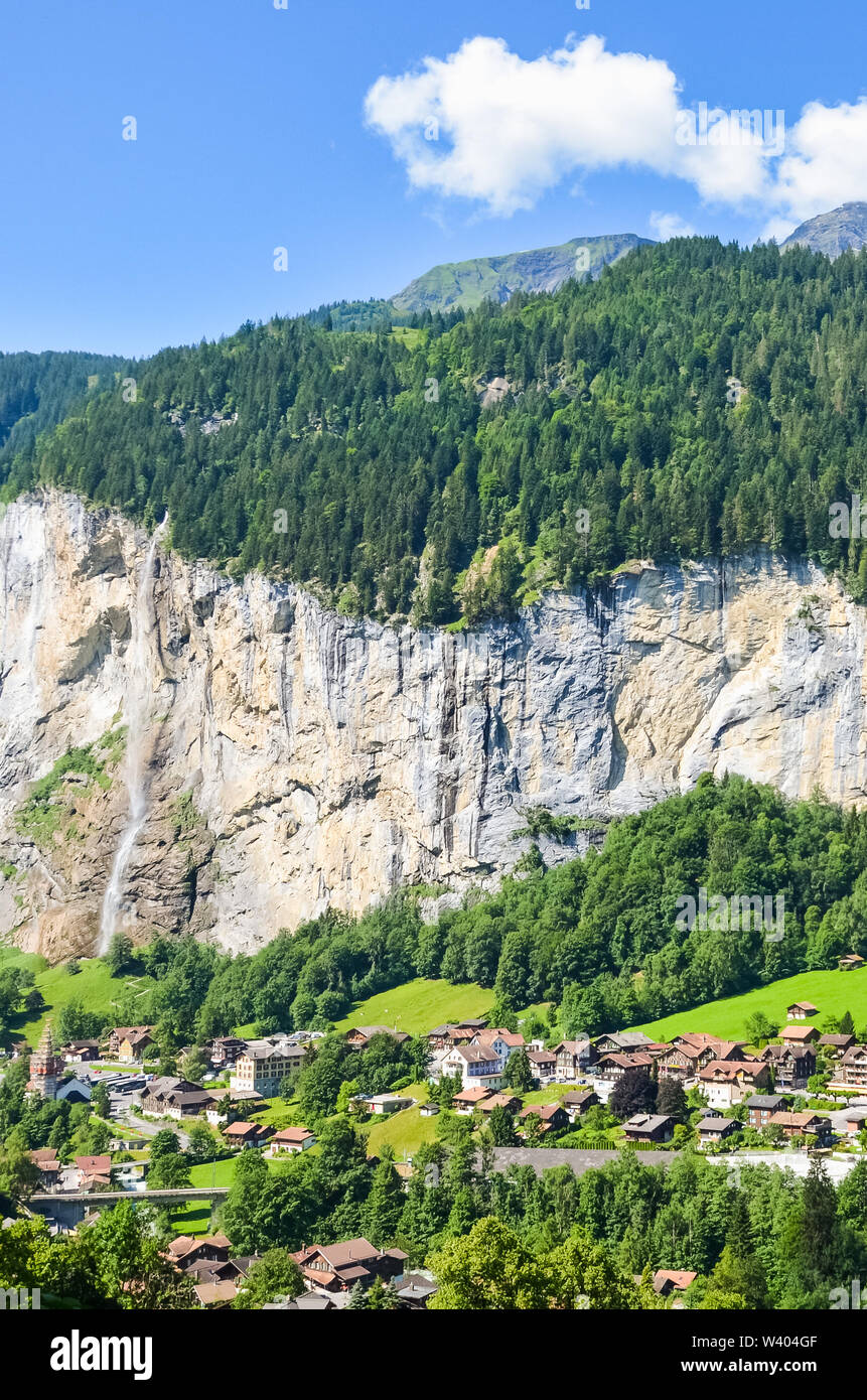 Lauterbrunnen, Switzerland photographed from above with famous Staubbach Falls. Summer Alpine landscape, Swiss Alps. Picturesque village. Rocks. Stock Photo