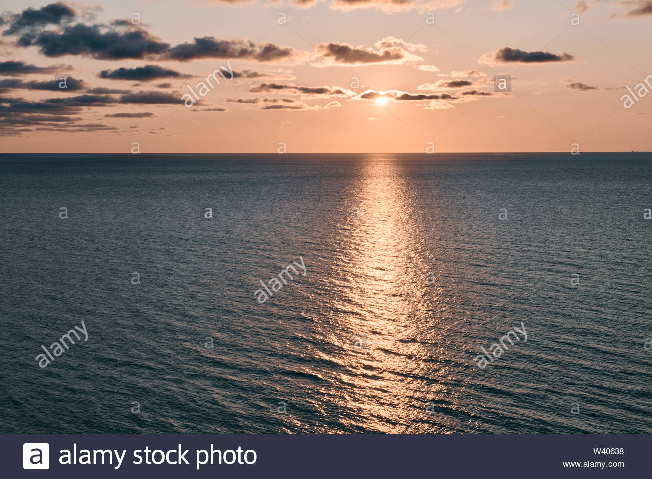 Dramatic skies over the blue sea just before sunset in northern Denmark. - Stock Image
