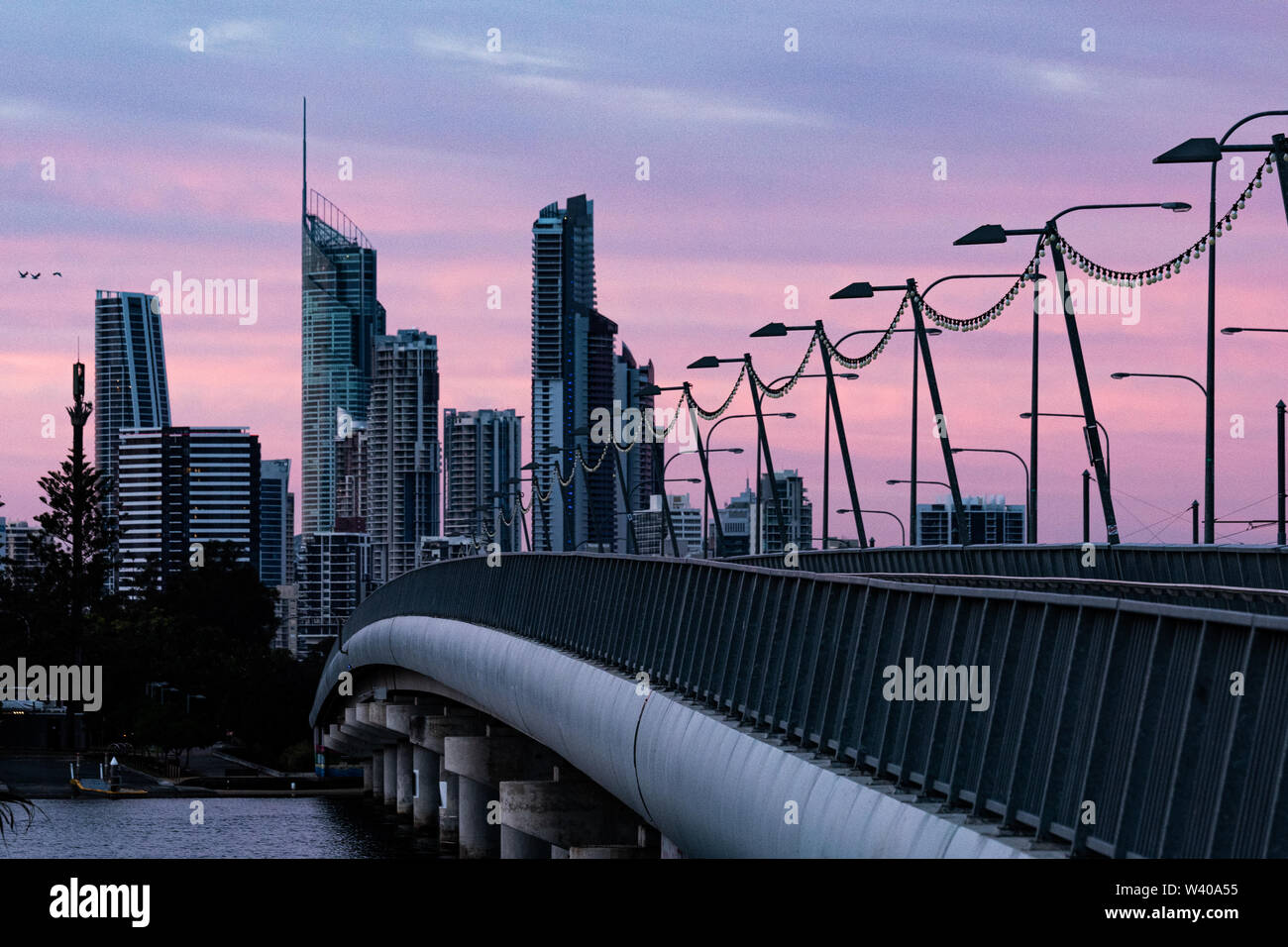 Blue hour lights up the sky over the Nerang River, Queensland. - Stock Image