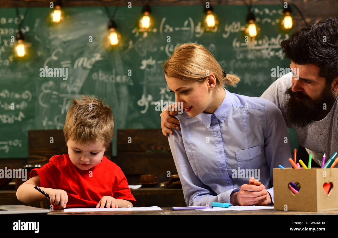 Studying mathematics educational background, High school college students studying and reading together in class education concepts, Teacher is skille - Stock Image
