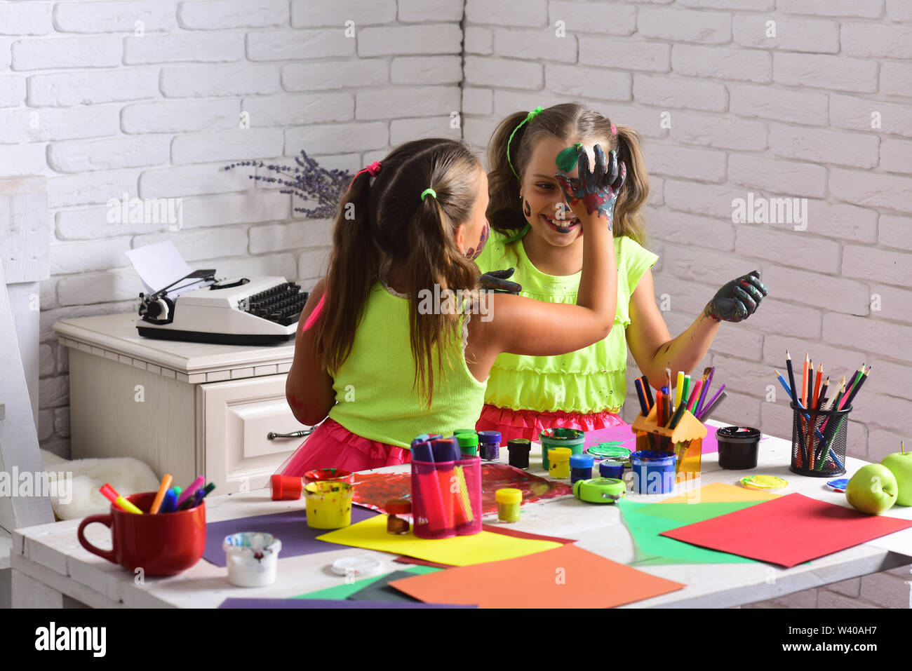 Body Art And Painting Girls Drawing On Face Skin With Paints Kids Learning And Playing Children Artists With Painted Hands Imagination Creativity Stock Photo Alamy