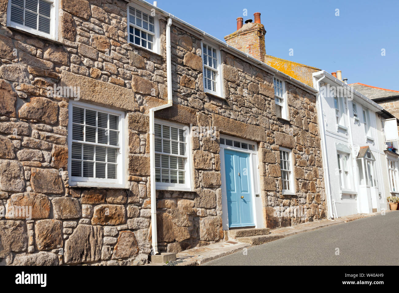 Narrow street with traditional stone houses in a coastal town of St Ives, Cornwall, United Stock Photo