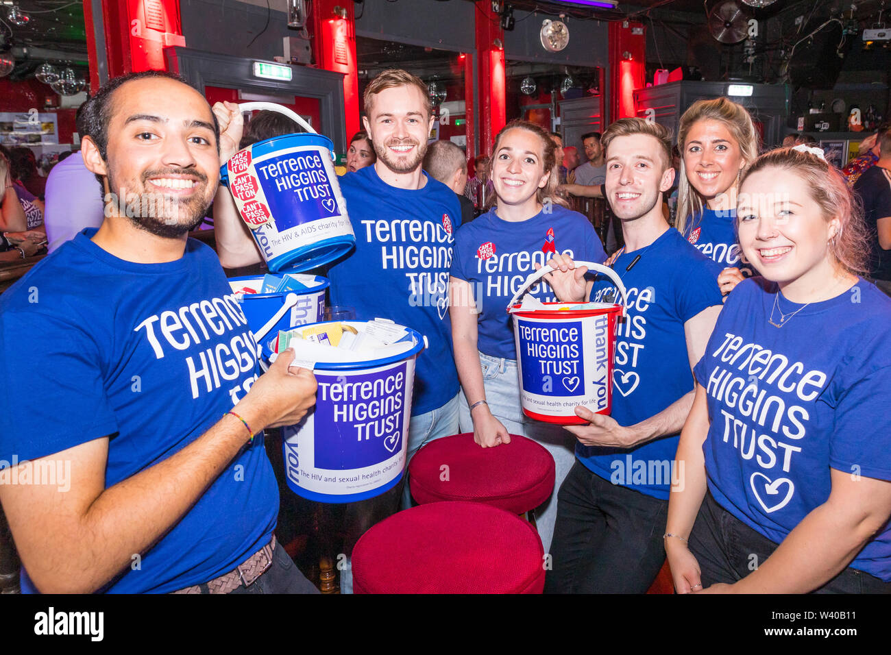 Terrence Higgins Trust volunteers with collection buckets Stock Photo