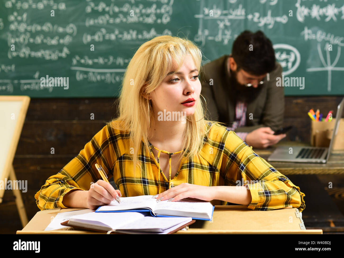 Students studying and testing lesson from teacher in classroom at university. Student looks for studying method that suits his learning style. Student - Stock Image