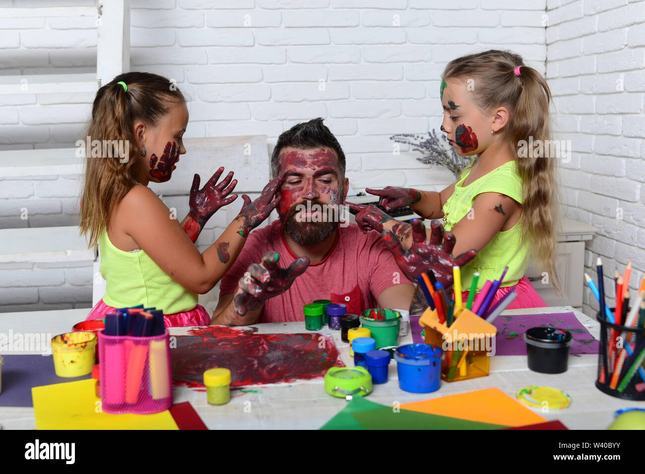 Daughters And Dad With Painted Hands Body Art And Painting Girls Drawing On Man Face Skin With Colorful Paints Fathers Day And Family Concept Crea Stock Photo Alamy