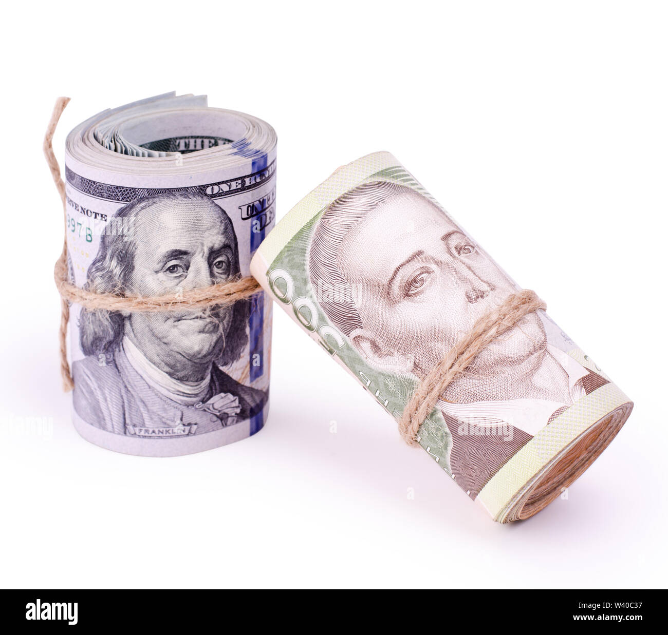 Tubes of United States Dollars and Ukrainian Hryvnia UAH Banknotes Isolated on a White. Financial business background. - Stock Image