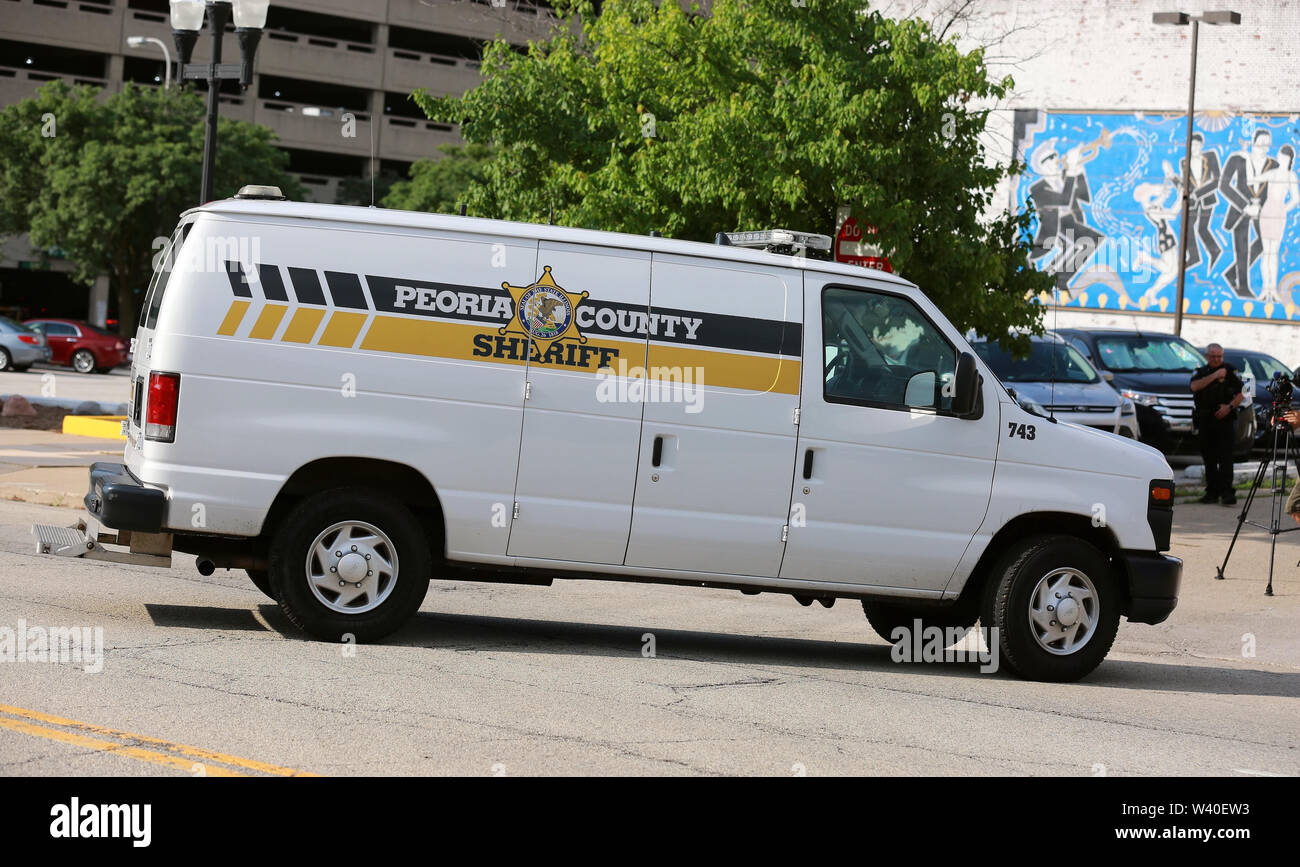 (190718) -- PEORIA (U.S.), July 18, 2019 (Xinhua) -- A Peoria County prison van carrying Brendt Christensen heads to a federal courthouse building in Peoria, Illinois, the United States, on July 18, 2019. Brendt Christensen, the kidnapper and killer of Chinese scholar Zhang Yingying in 2017, was sentenced on Thursday to life imprisonment without possibility of release, Judge James Shadid announced the verdict in a federal court of Peoria in the U.S. state of Illinois, after the jury failed to reach a unanimous decision on whether he should be sentenced to death or life in prison. (Xinhua/Wang - Stock Image