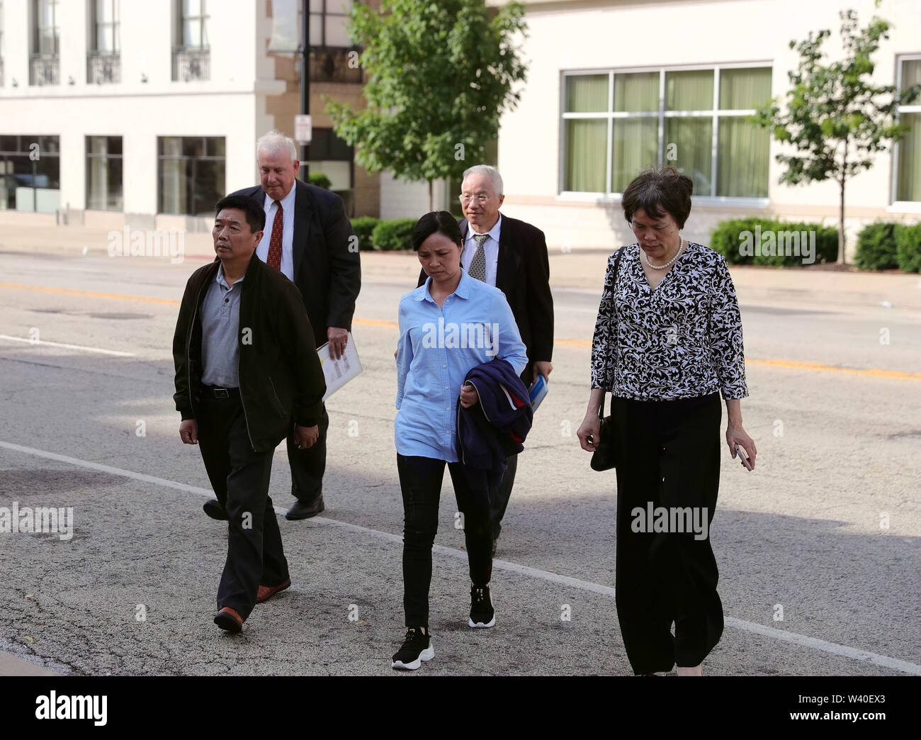 Peoria, USA. 18th July, 2019. Family members of Chinese scholar Zhang Yingying head to a federal courthouse building in Peoria, Illinois, the United States, on July 18, 2019. Brendt Christensen, the kidnapper and killer of Chinese scholar Zhang Yingying in 2017, was sentenced on Thursday to life imprisonment without possibility of release, Judge James Shadid announced the verdict in a federal court of Peoria in the U.S. state of Illinois, after the jury failed to reach a unanimous decision on whether he should be sentenced to death or life in prison. Credit: Wang Ping/Xinhua/Alamy Live News - Stock Image