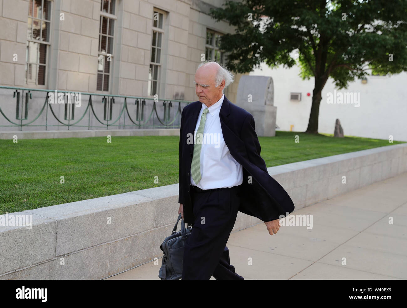 (190718) -- PEORIA (U.S.), July 18, 2019 (Xinhua) -- Robert Tucker, defense attorney for Brendt Christensen, heads to a federal courthouse building in Peoria, Illinois, the United States, on July 18, 2019. Brendt Christensen, the kidnapper and killer of Chinese scholar Zhang Yingying in 2017, was sentenced on Thursday to life imprisonment without possibility of release, Judge James Shadid announced the verdict in a federal court of Peoria in the U.S. state of Illinois, after the jury failed to reach a unanimous decision on whether he should be sentenced to death or life in prison. (Xinhua/Wang - Stock Image