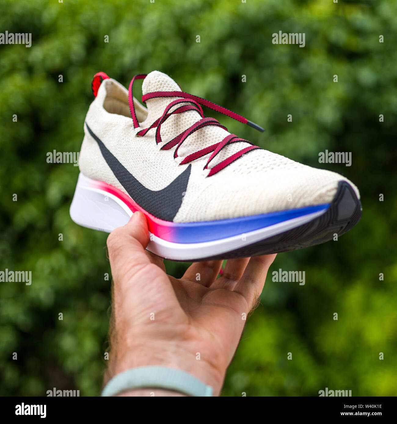 0cf6728e Paris, France - Jul 8, 2019: Athlete man hand holding presenting new running