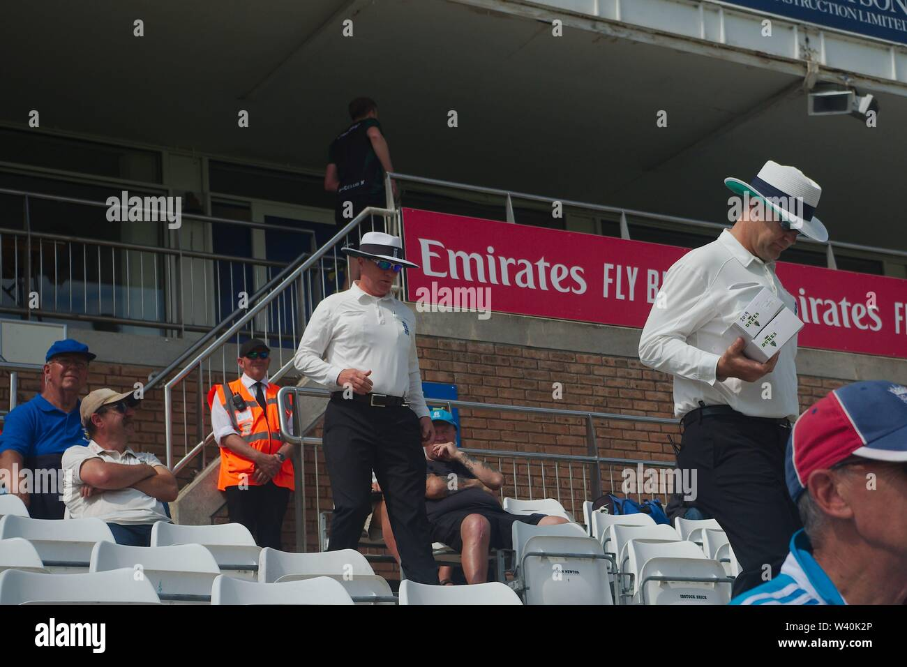 Chester le Street, England, 15 July 2019. Umpires James Middlebrook and Ben Debenham taking to the field at the start of day 3 in the Specsavers County Championship match between Durham and Worcestershire at the Emirates Riverside, Chester le Street. - Stock Image