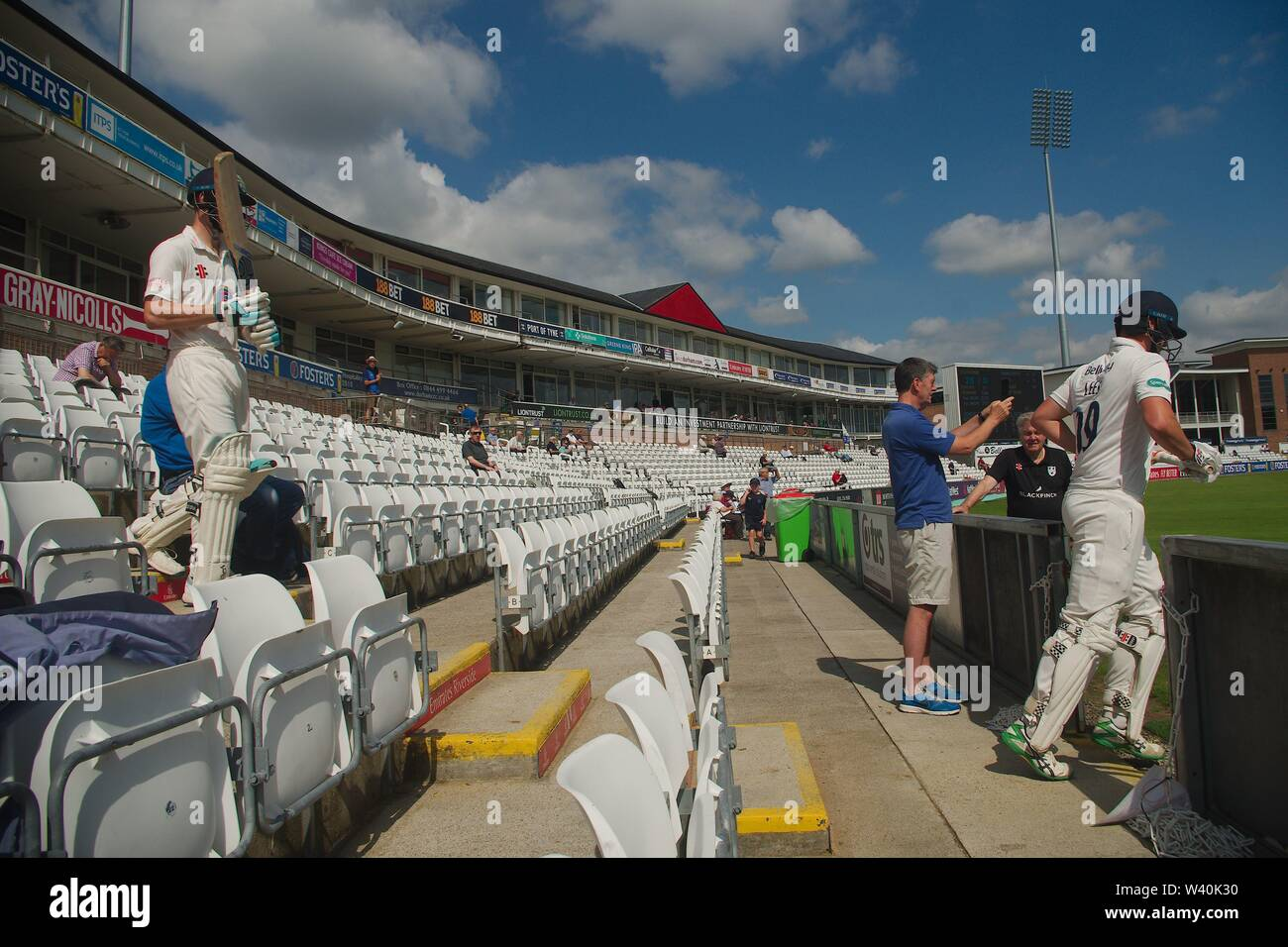 Chester le Street, England, 15 July 2019. Durham batsmen Cameron Bancroft and Alex Lees taking to the field at the start of day 3 in the Specsavers County Championship match against Worcestershire at the Emirates Riverside, Chester le Street. - Stock Image