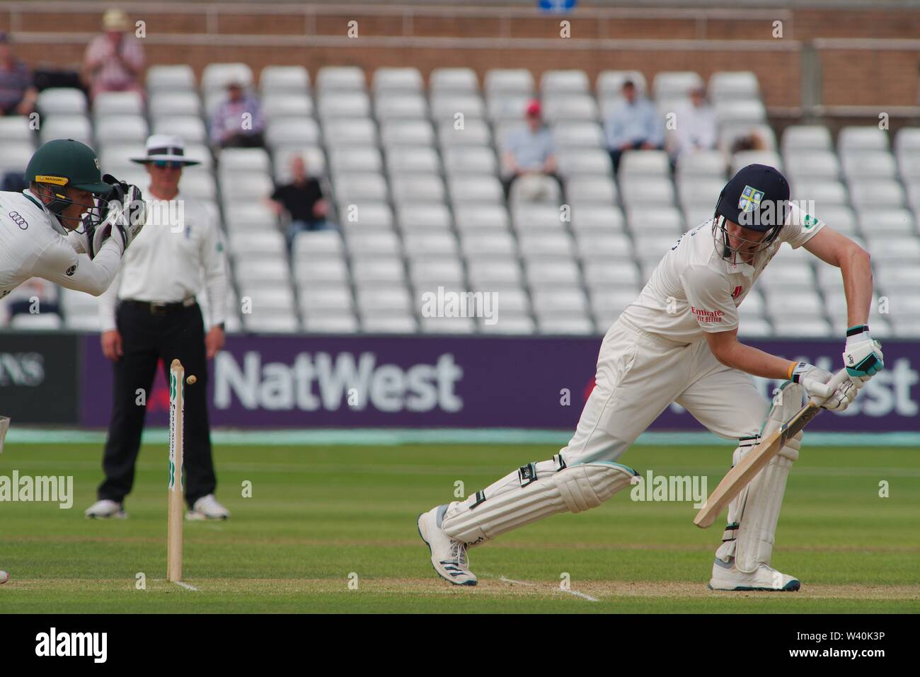 Chester le Street, England, 15 July 2019. Ben Cox, Worcestershire wicket keeper, attempts to stump Durham batsman Cameron Bancroft during their Specsavers County Championship match between Durham and Worcestershire at the Emirates Riverside, Chester le Street. - Stock Image