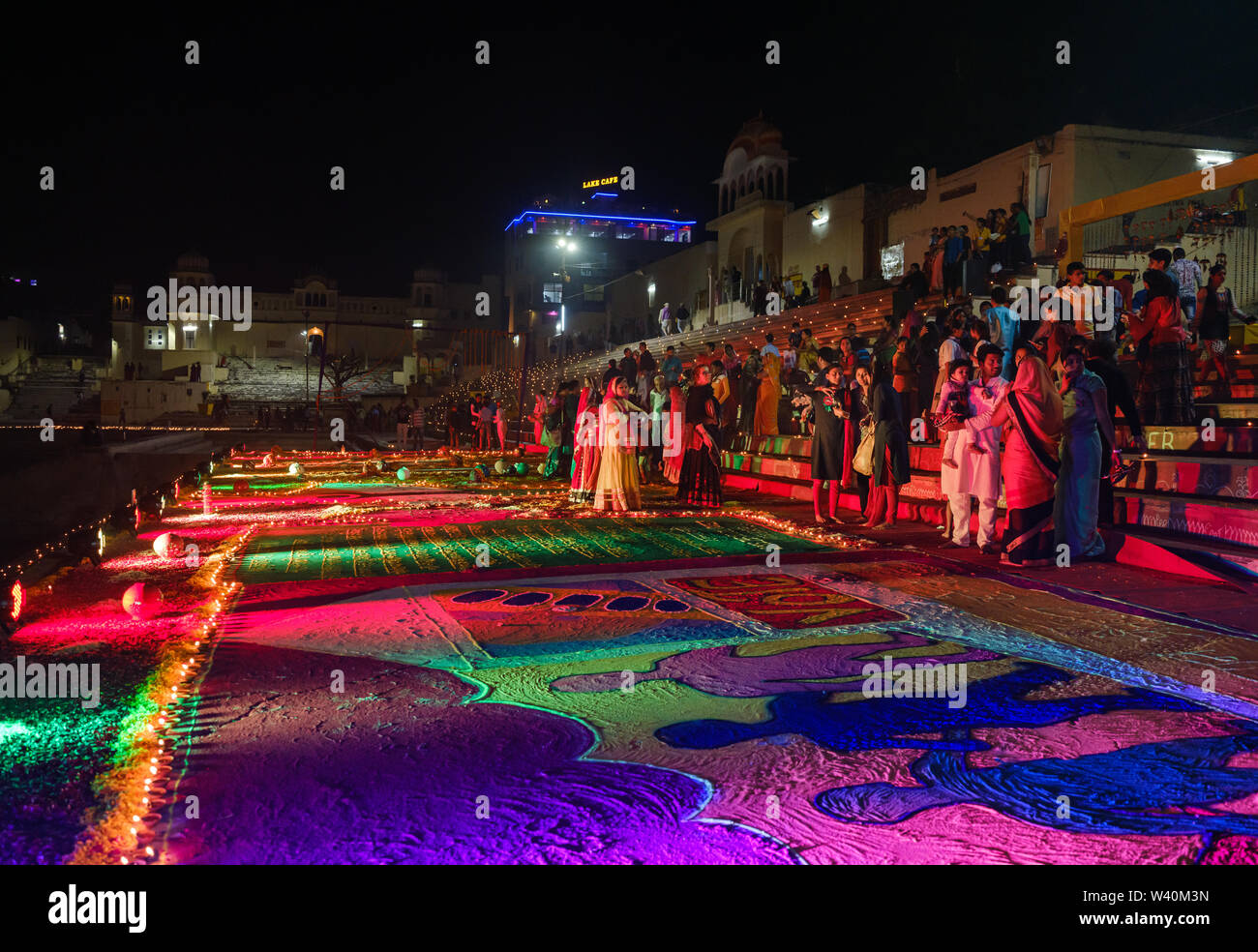 PUSHKAR, INDIA - CIRCA NOVEMBER 2018: Woman walking in the Pushkar Ghats during the opening ceremonies of the Camel Fair. It is one of the world's lar - Stock Image