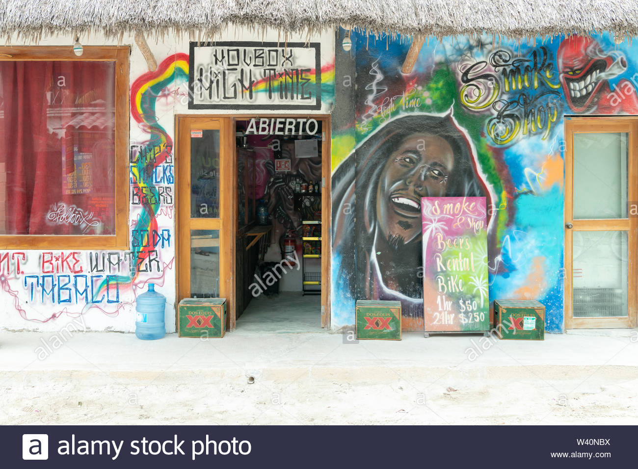 A shop in Isla Holbox, Mexico called High Time which rents bicycles and sells beer, water, tobacco, chips and snacks. - Stock Image